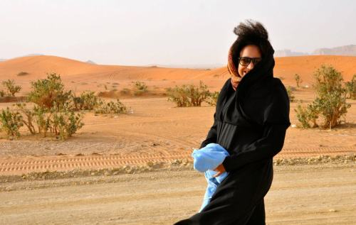 Rocking the Abaya and the 'fro in the desert.